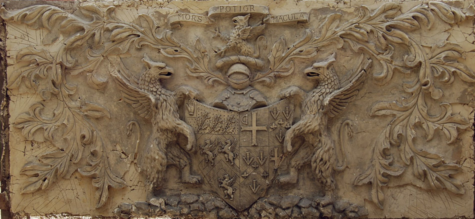 An Edwardian relief-cast plaster armorial over mantel panel-0
