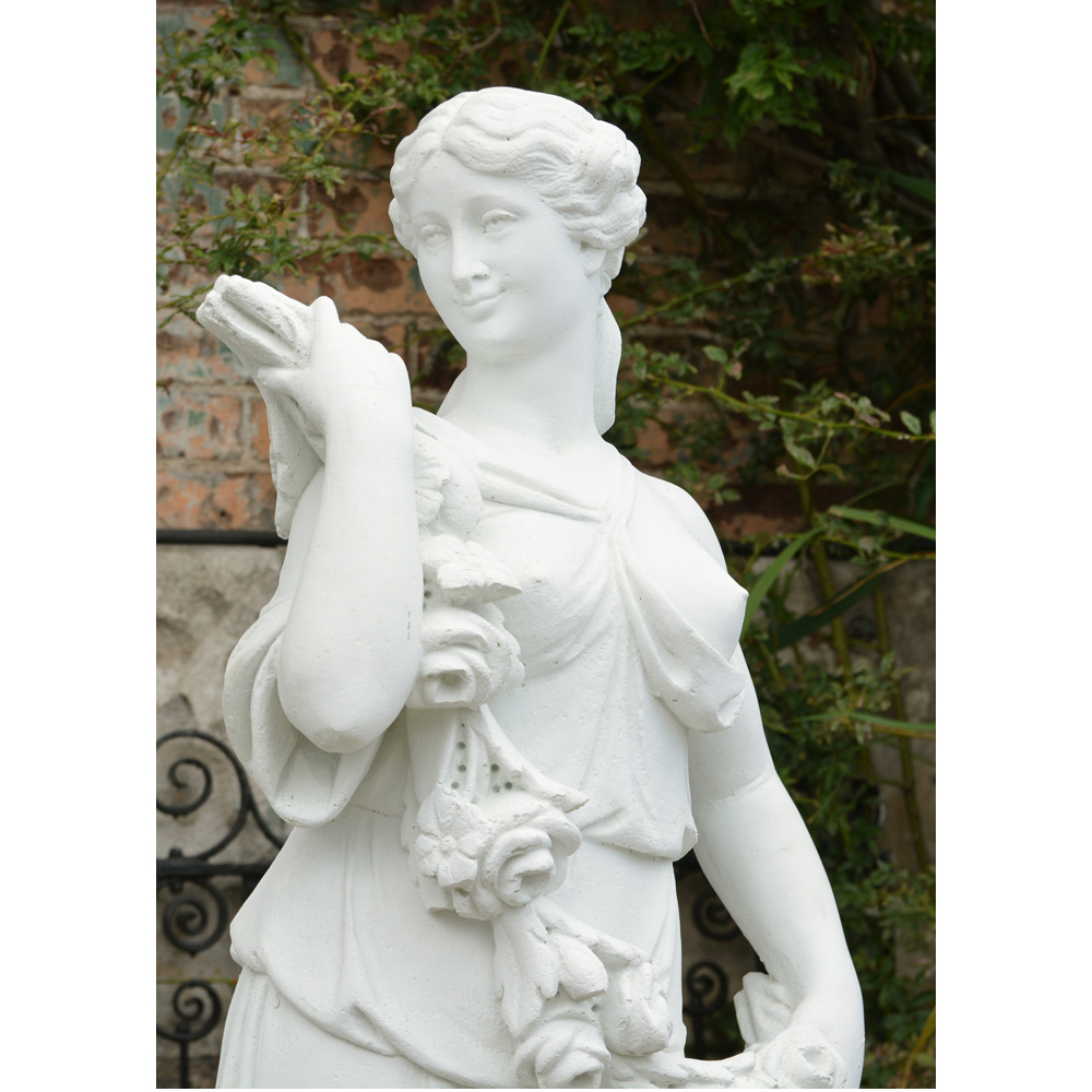 An Italian reconstituted marble figure of a maiden personifying 'Spring',-83773