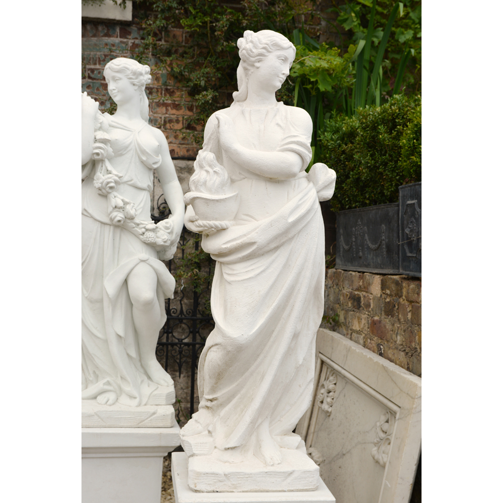 An Italian reconstituted marble figure of a maiden personifying 'Winter',-0