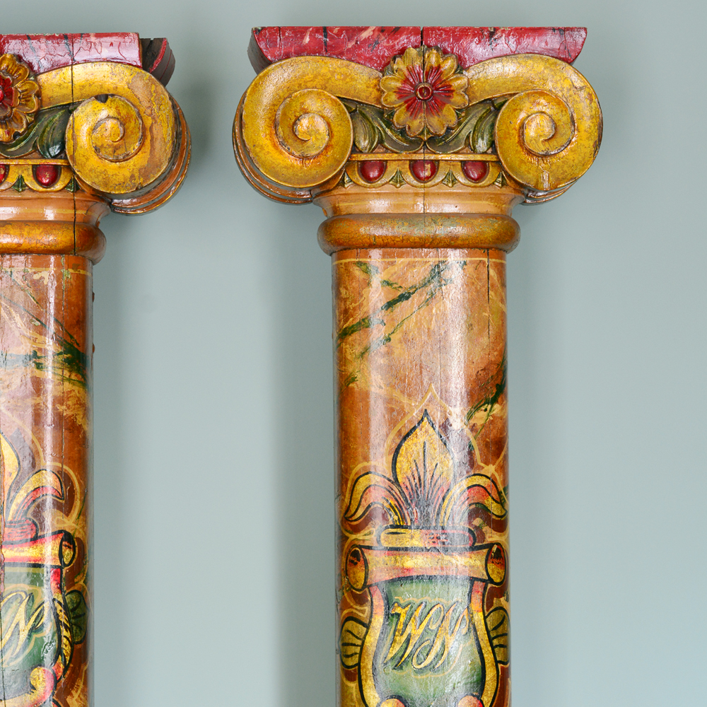 A pair of wooden fairground columns,-80171