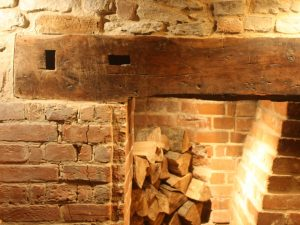 A fireplace lintel in Oxfordshire with Apatropaic marks