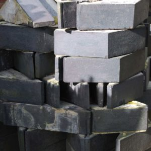 A quantity of Staffordshire Blue triangular coping bricks-0