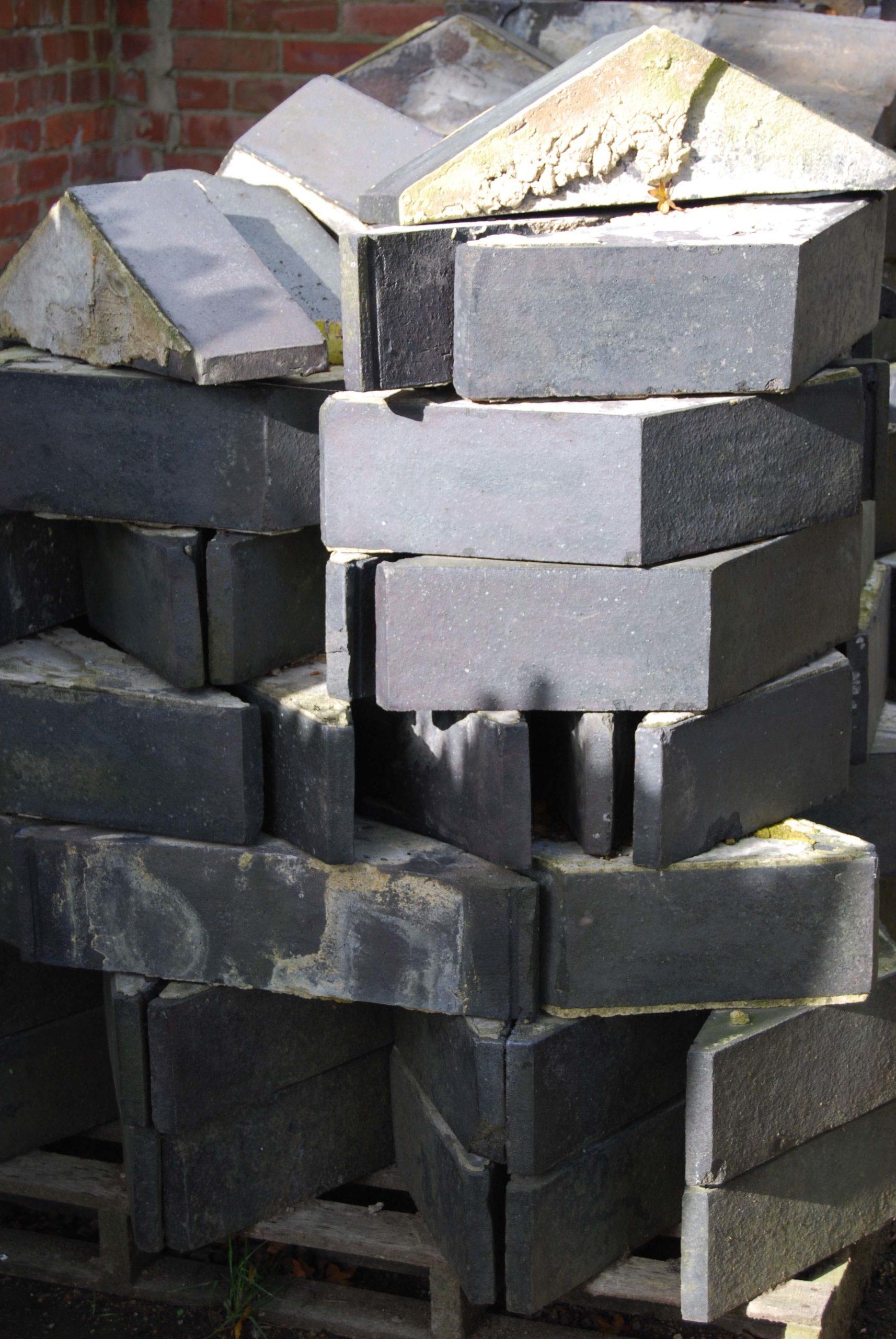 A quantity of Staffordshire Blue triangular coping bricks-0