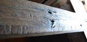 Apotropaic carvings in an oak lintel