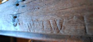 Apotropaic marks in the oak beam at LASSCO Three Pigeons