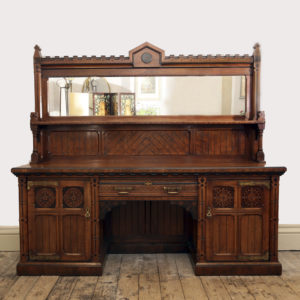 An imposing Reformed Gothic oak, walnut, ebonized and marquetry sideboard, -0