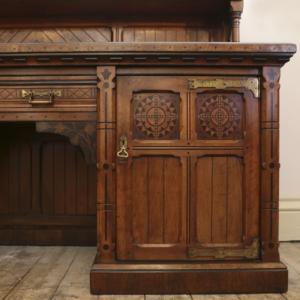An imposing Reformed Gothic oak, walnut, ebonized and marquetry sideboard, -82537