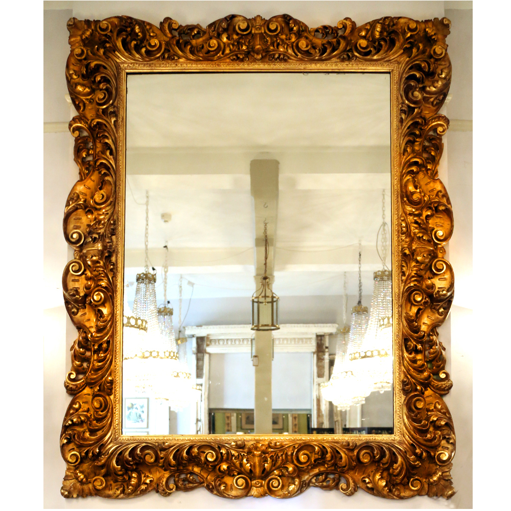 A large and impressive continental giltwood mirror,-82987