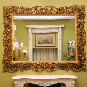 A large and impressive continental giltwood mirror,-0