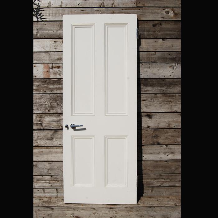 A hardwood four panelled door-0