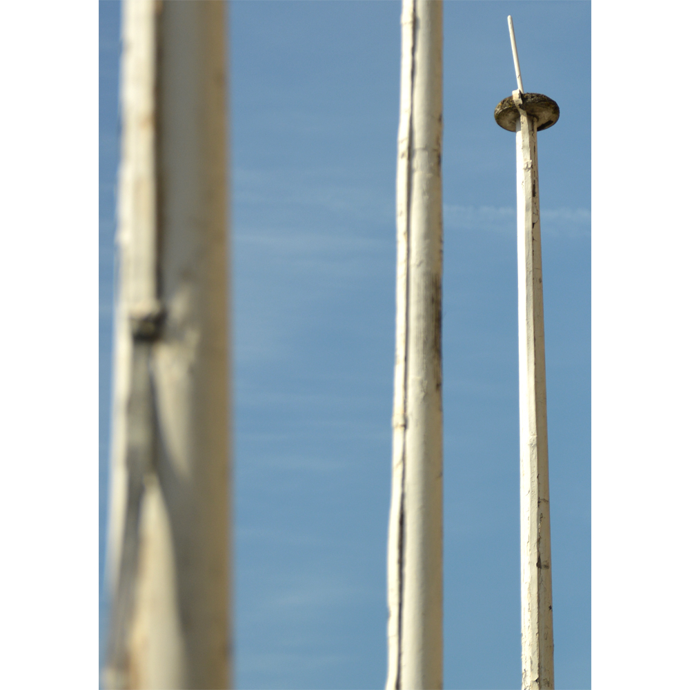 A set of three wooden flagpoles,-84068