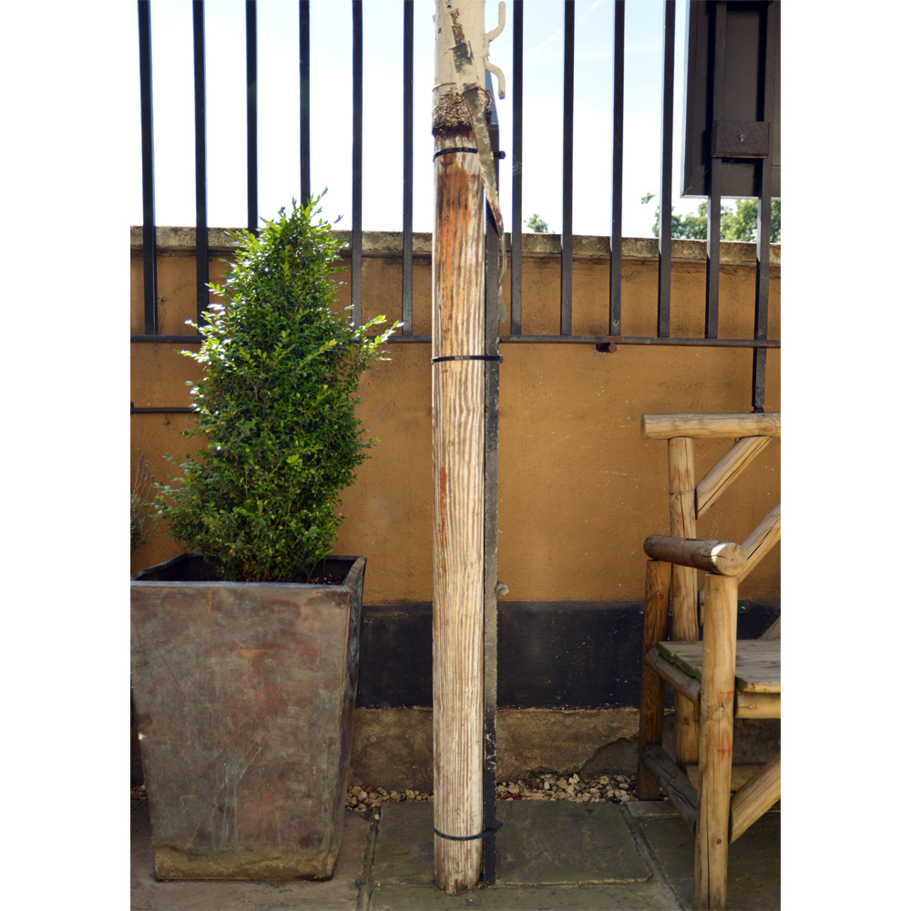 A set of three wooden flagpoles,-84067