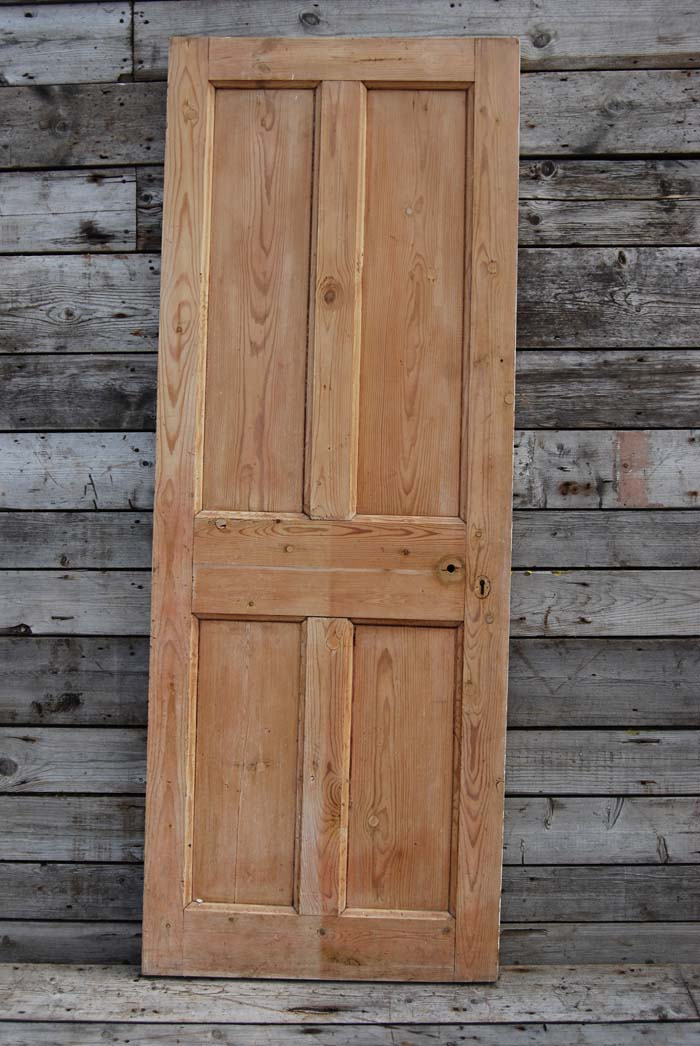 A four paneled pine door