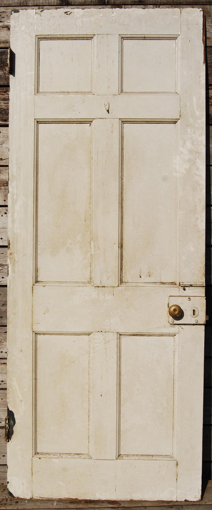 A panelled hardwood door