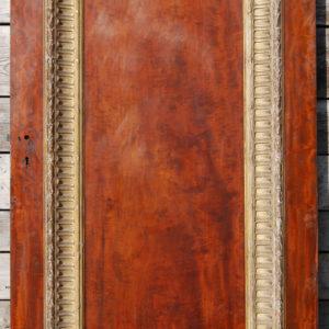 A large single panel mahogany door