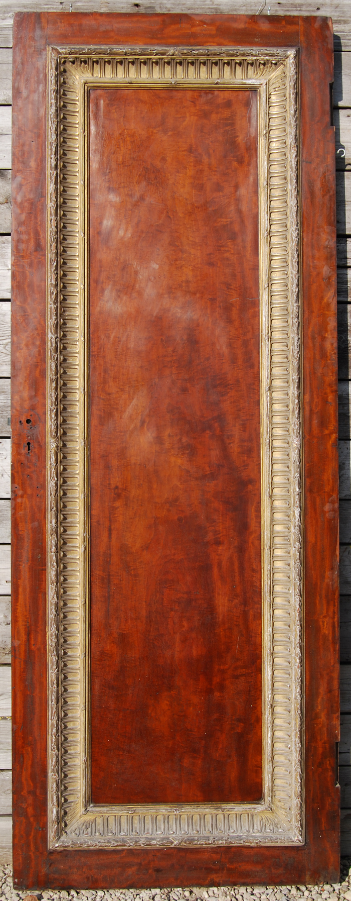 A large single panel mahogany door