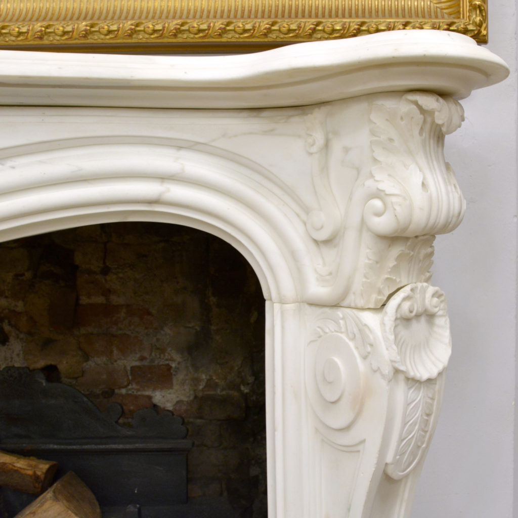 A large English Rococo Revival White Carrara marble chimneypiece,-87108
