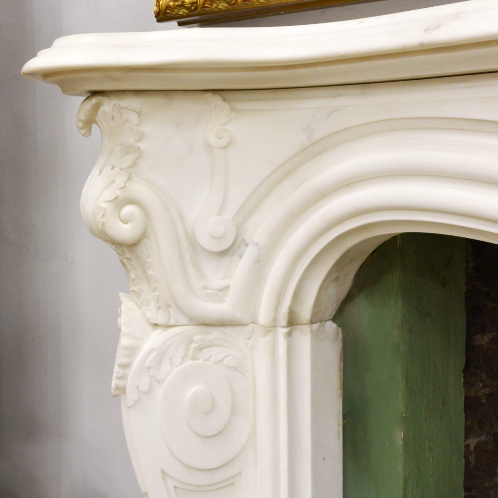 A large English Rococo Revival White Carrara marble chimneypiece,-87100