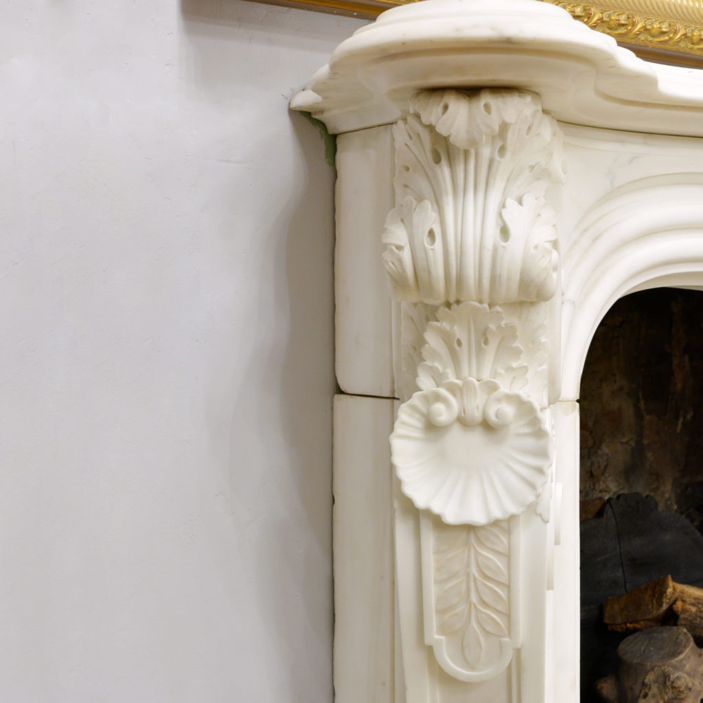A large English Rococo Revival White Carrara marble chimneypiece,-87106