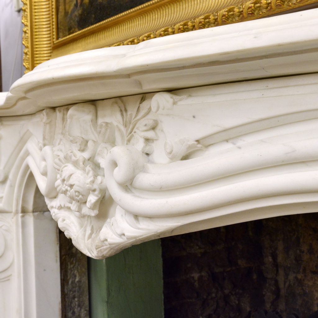 A large English Rococo Revival White Carrara marble chimneypiece,-87104