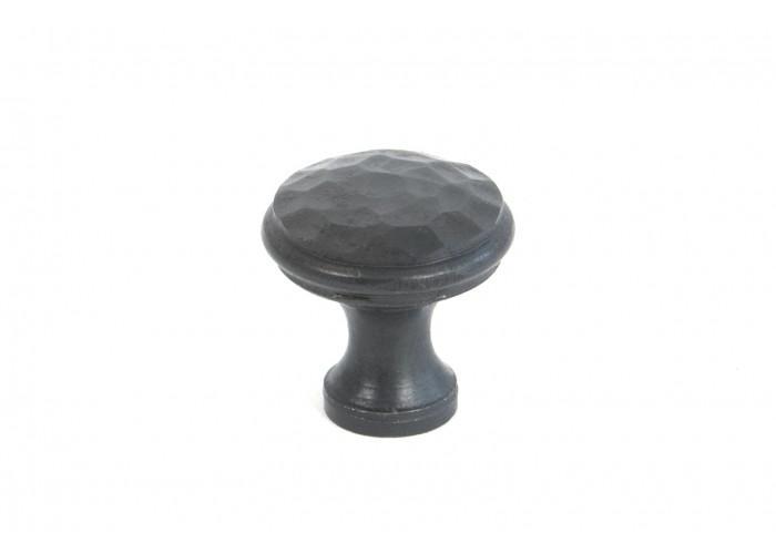 A small beaten cupboard knob