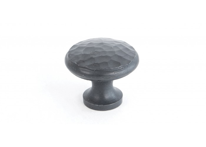 A medium beaten cupboard knob