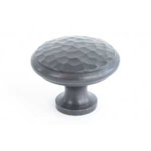 A large beaten cupboard knob
