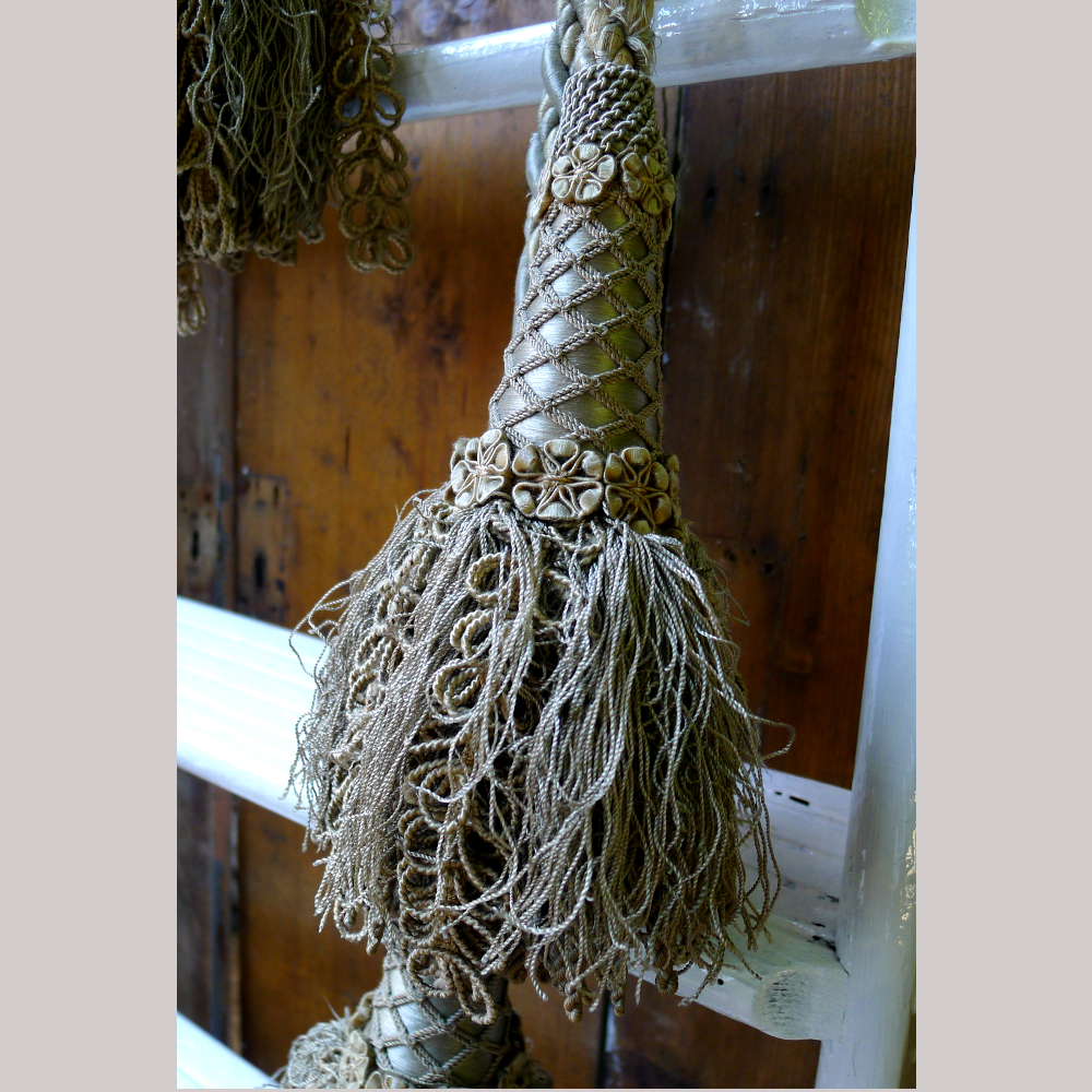 Silver tassels with netting and floral details-0