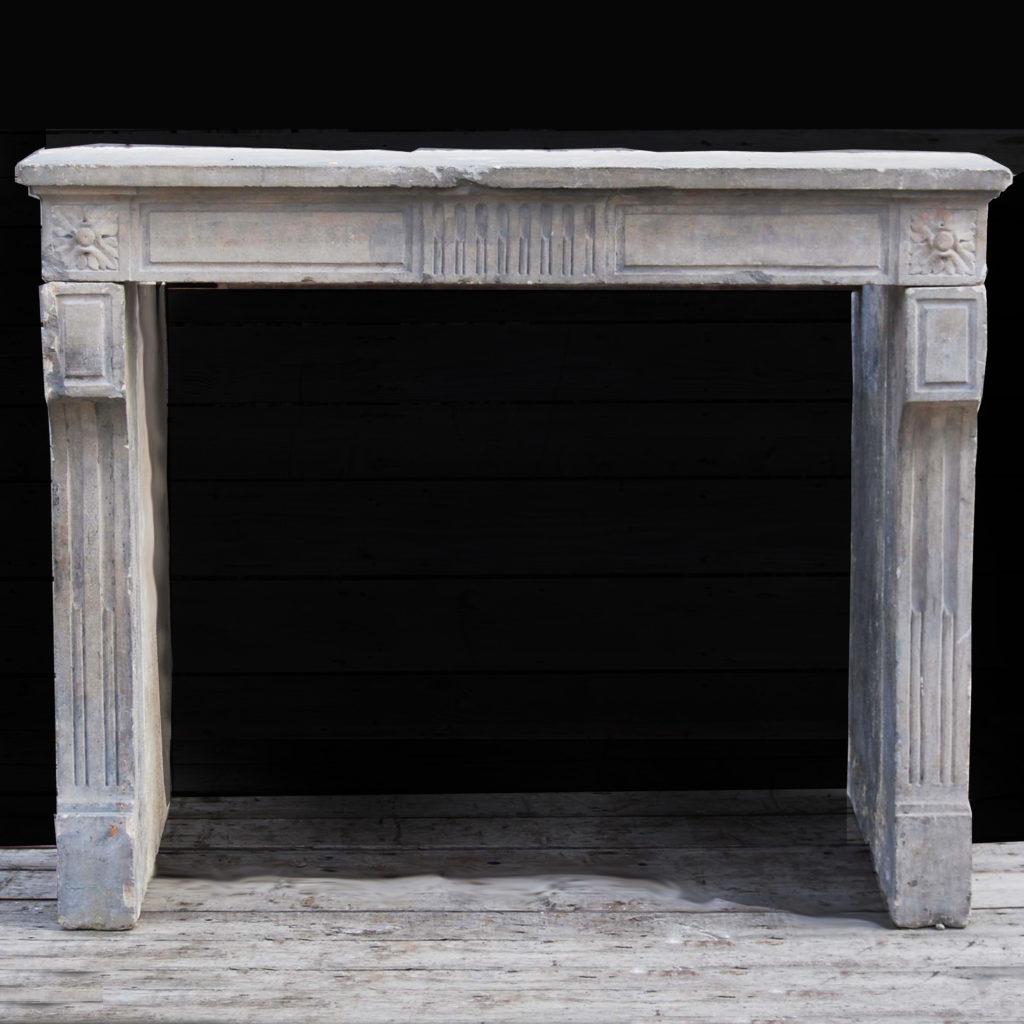 A Louis XVI Caen stone chimneypiece-0