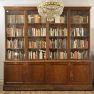 A large poplar and glazed bookcase,-0