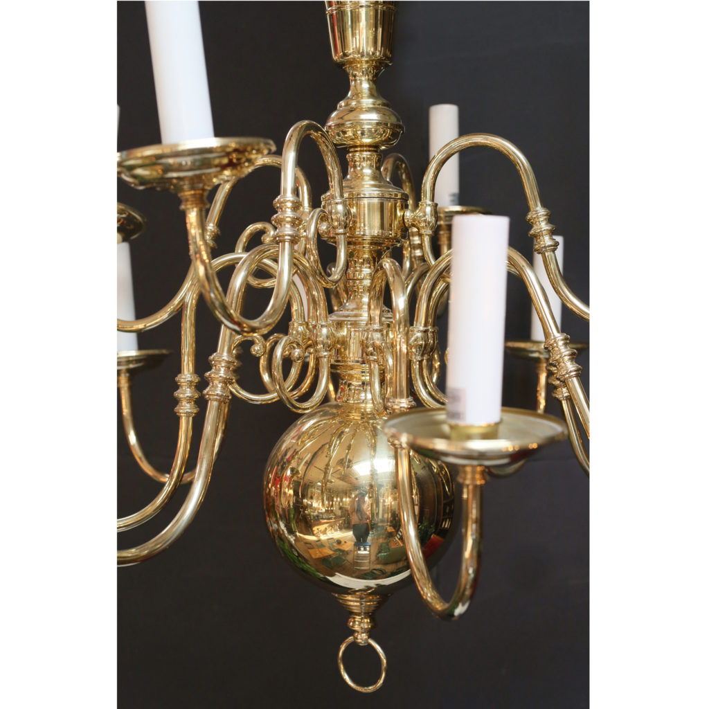 A large two tier Dutch style brass chandelier,-85660