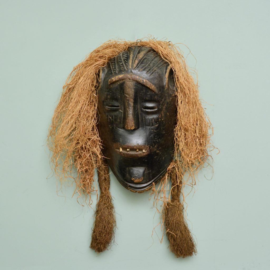 A Poro tribe mask,-0