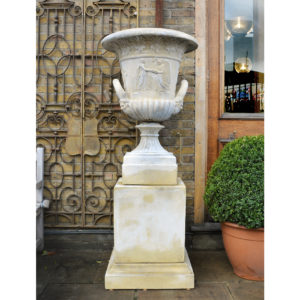 An English reconstituted stone Campana urn,-0