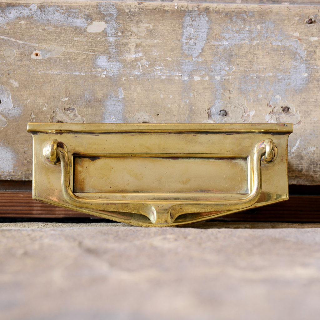 A brass letterplate,-95177