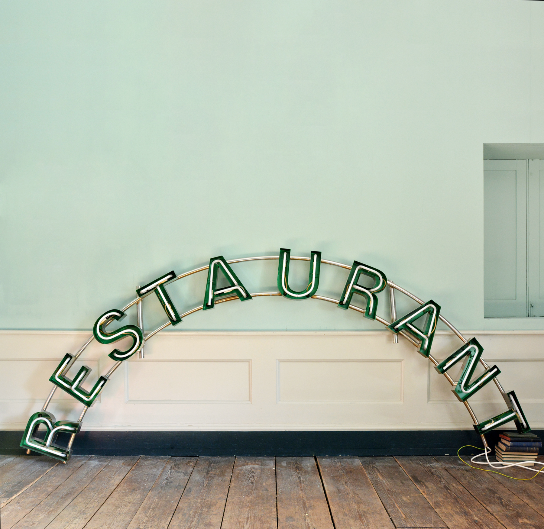 Chrome and neon 'Restaurant' sign