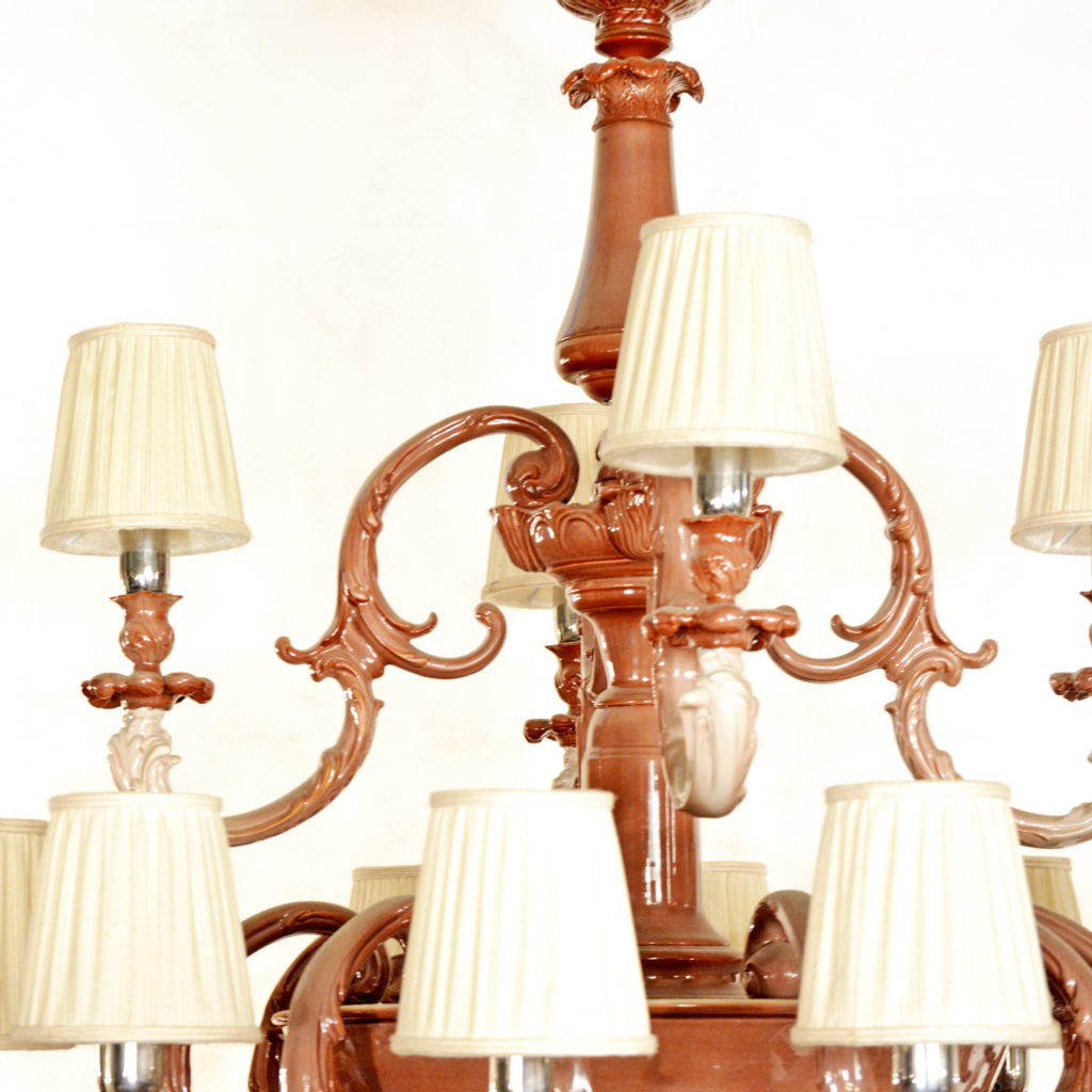 A large two tier sixteen branch ceramic chandelier,-87243