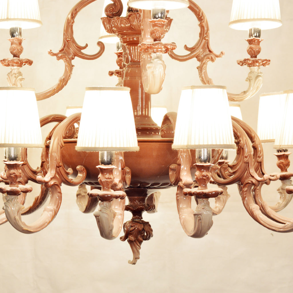 A large two tier sixteen branch ceramic chandelier,-87245