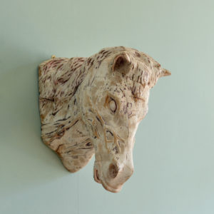 Carved wood horse's head