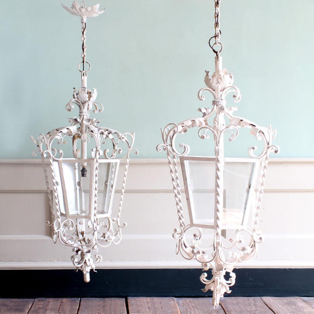 A pair of wrought iron lanterns, -0