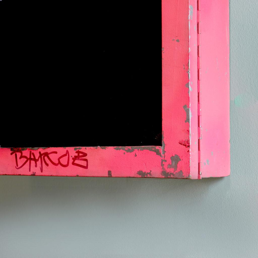A neon pink illuminated menu board, -91579