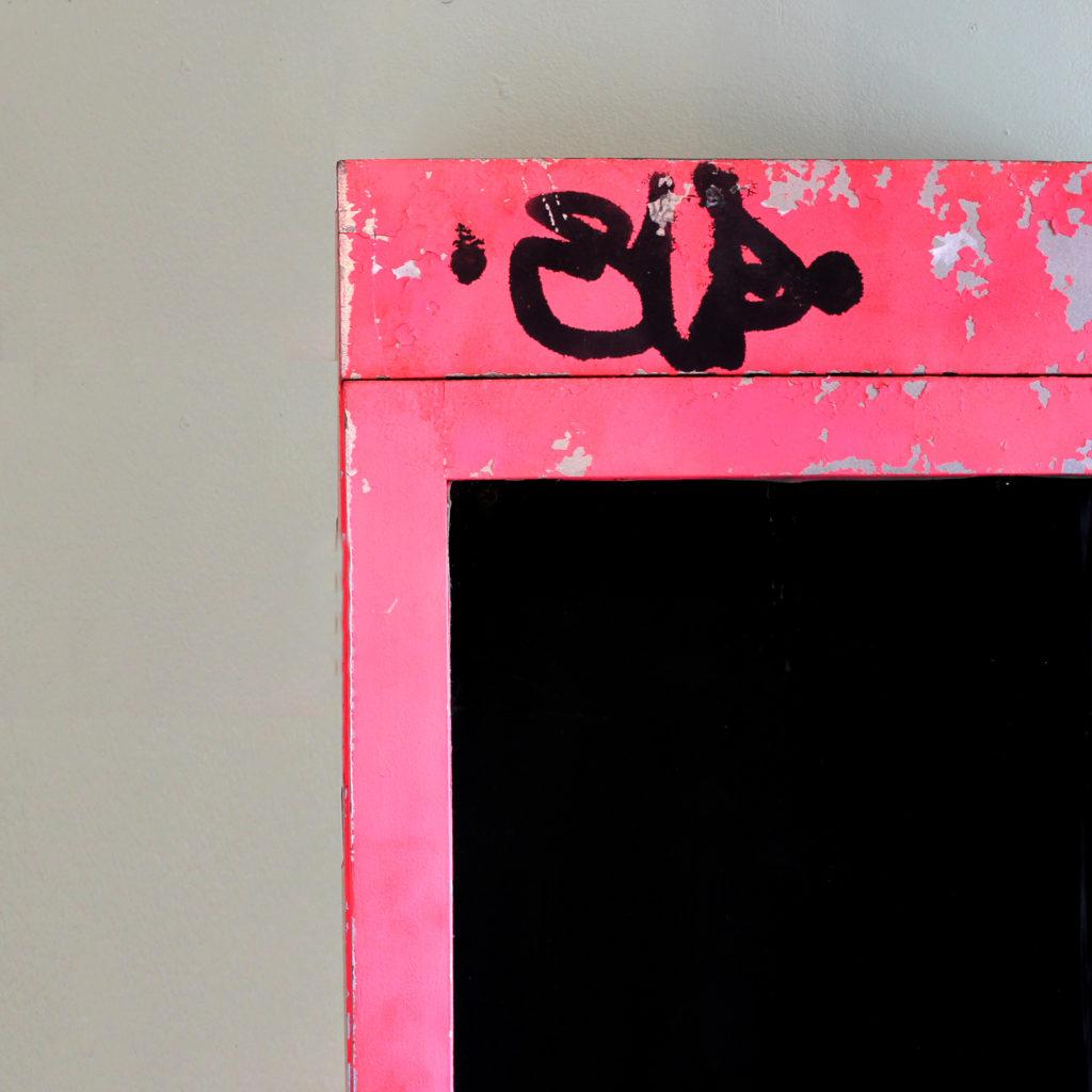 A neon pink illuminated menu board, -91577