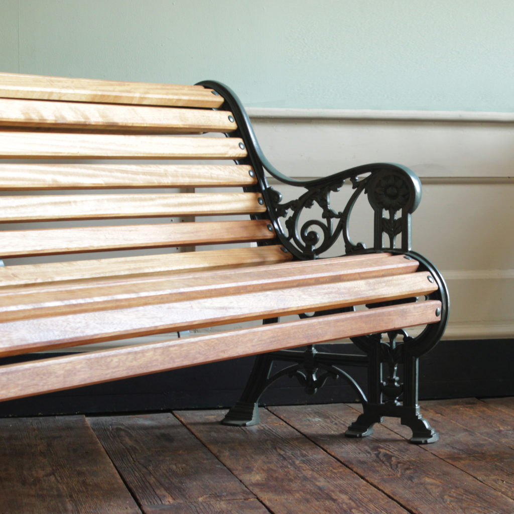 Decorative cast iron and teak garden bench,-94144