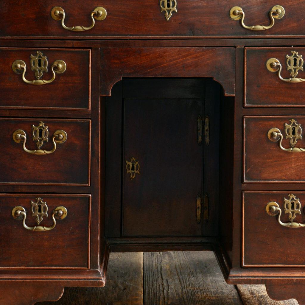 A George II mahogany kneehole desk,-96015