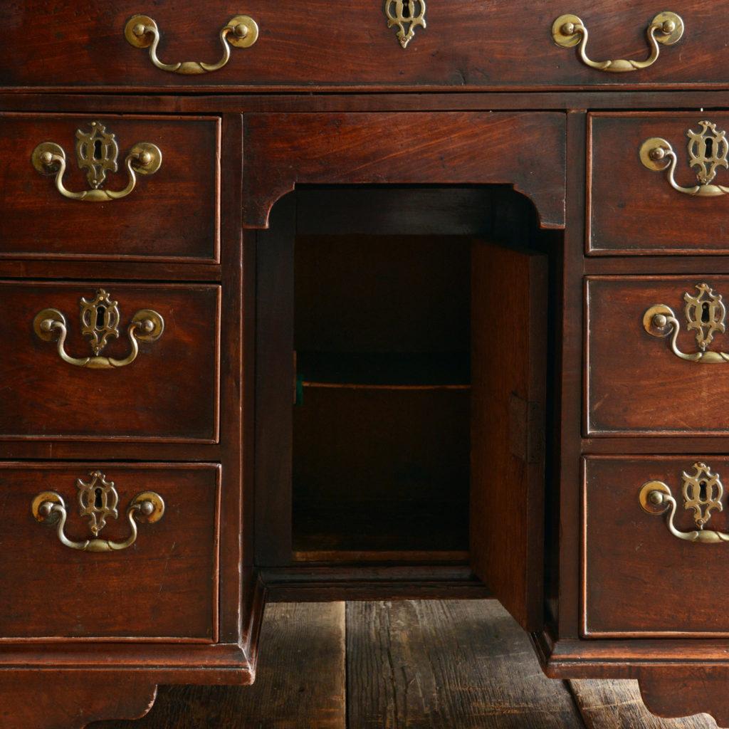 A George II mahogany kneehole desk,-96017