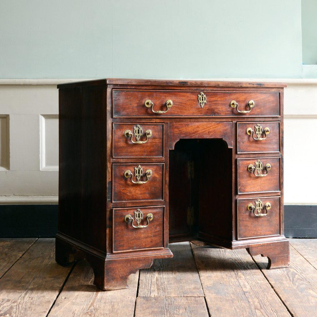 A George II mahogany kneehole desk,-96005