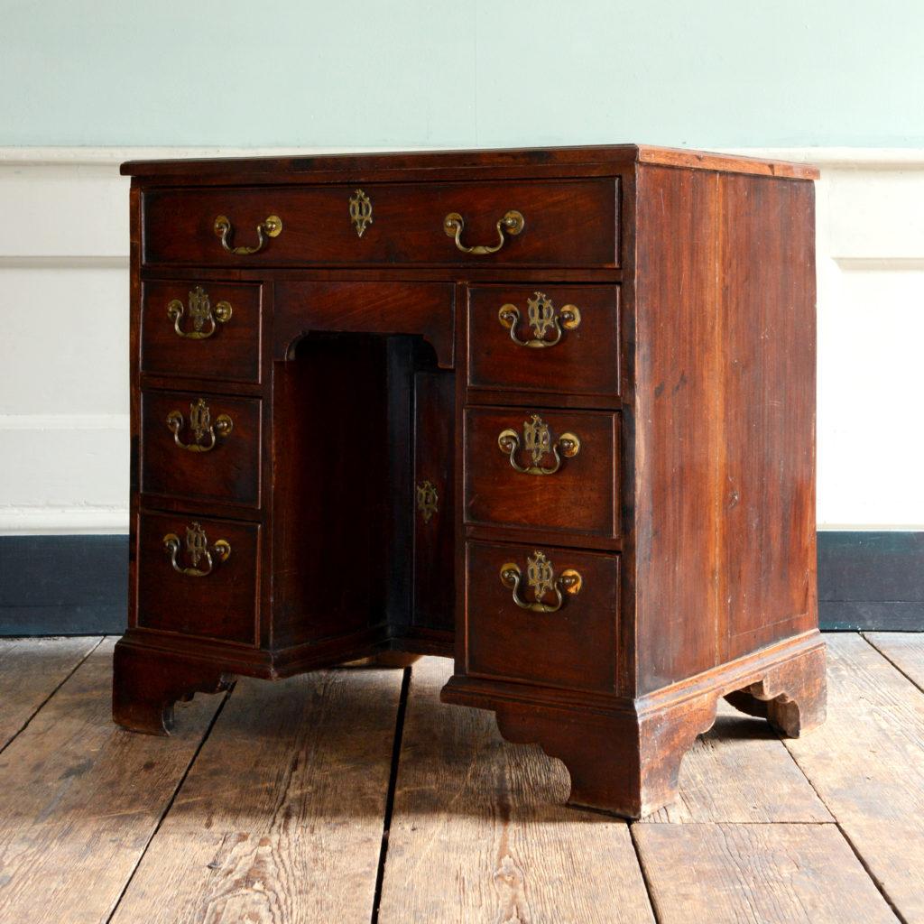 A George II mahogany kneehole desk,-96010