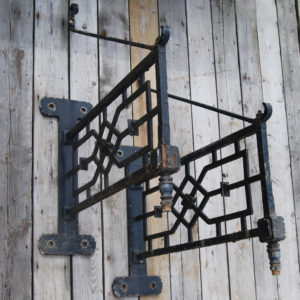 A pair of wrought iron lamp brackets-0