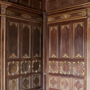 A spectacular French parcel-gilt oak panelled dining room,-0