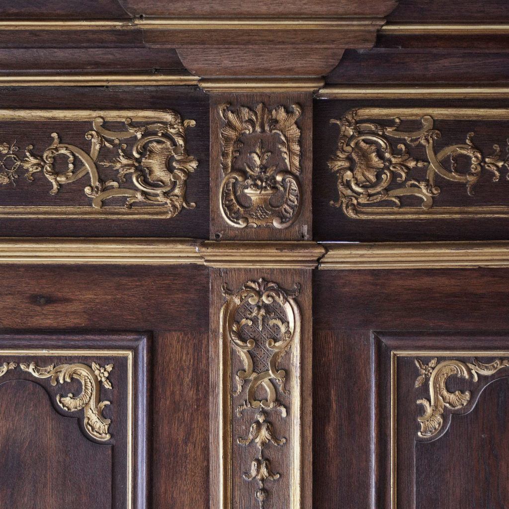A spectacular French parcel-gilt oak panelled dining room,-105364