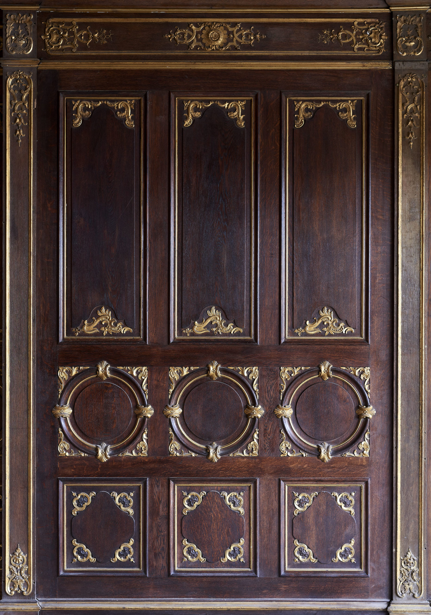A spectacular French parcel-gilt oak panelled dining room,-105362